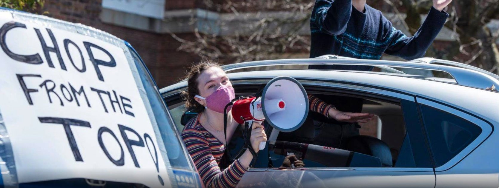 Car rally with UVM students protesting cuts to Liberal Arts